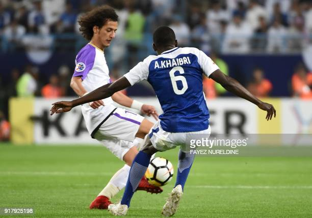 Al Hilal's Abdulmalek AlKhaibri fights for the ball with Al Ain's Mohammed Abdulrahman during the AFC Champions League group stage football match...
