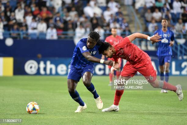 Al Hilal's Bafetimbi Gomis fights for the ball with Al Duhail's Ahmed Yasser during the AFC champions league Group C football match between KSA's Al...