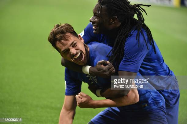 Al Hilal's Carlos Eduardo celebrates with his teammate Bafetimbi Gomis after scoring a goal during the AFC champions league Group C football match...