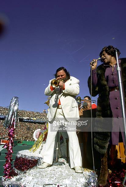 Al Hirt plays the trumpet and Ella Fitzgerald sings during the Halftime Show of Super Bowl VI between the Dallas Cowboys and Miami Dolphins at Tulane...