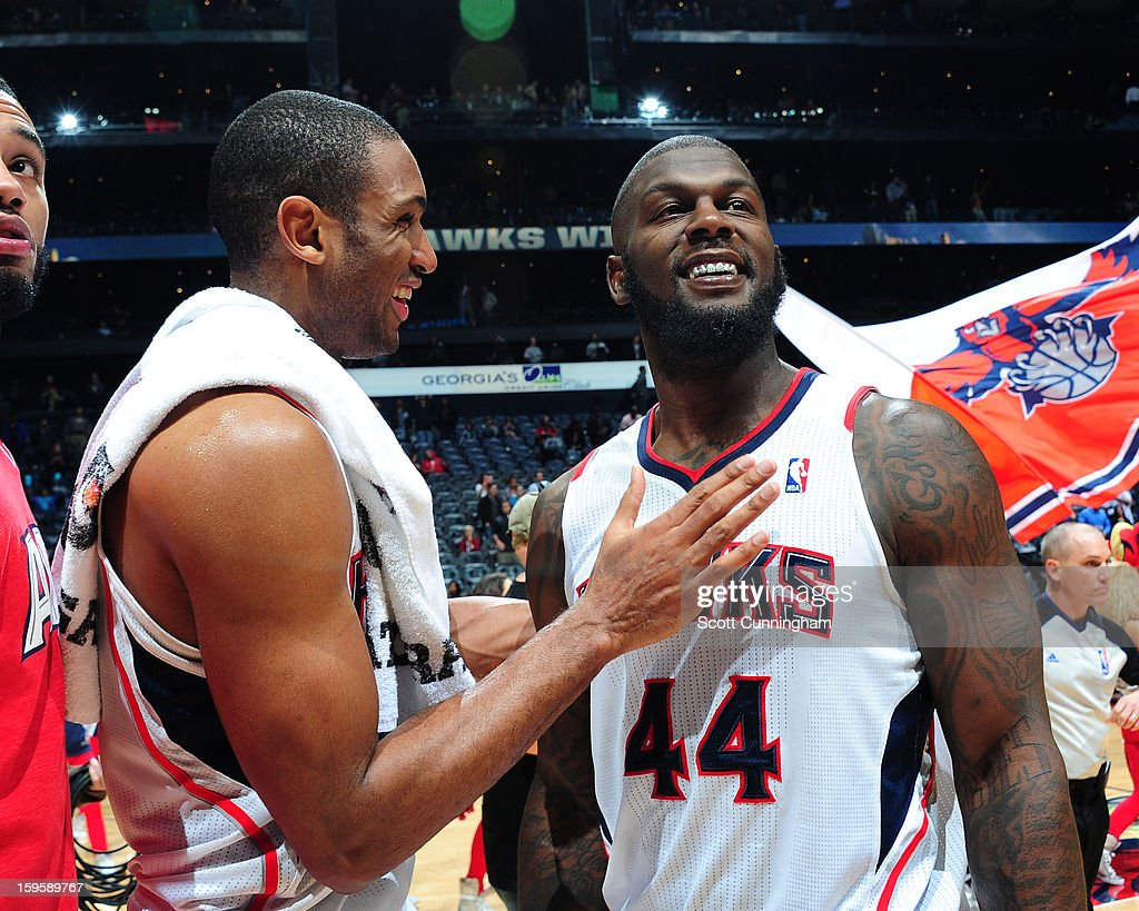 Al Horford #15 and Ivan Johnson #44 of the Atlanta Hawks smile after a victory against the Brooklyn Nets on January 16, 2013 at Philips Arena in Atlanta, Georgia.