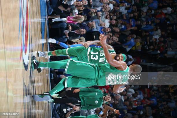 Al Horford and Marcus Morris of the Boston Celtics react against the Oklahoma City Thunder on November 3 2017 at Chesapeake Energy Arena in Oklahoma...