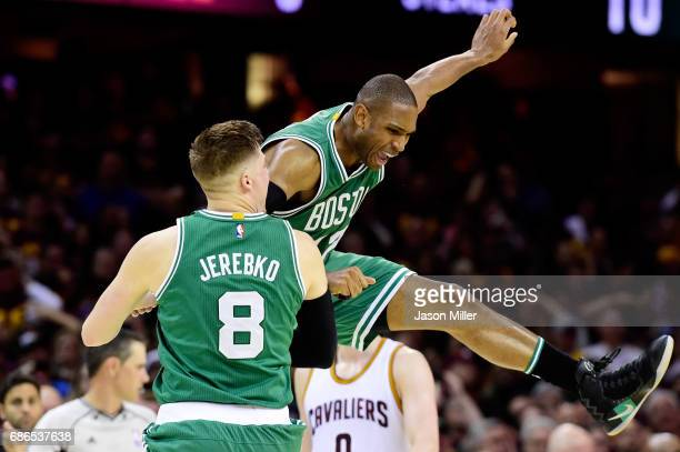 Al Horford celebrates with Jonas Jerebko of the Boston Celtics after their 111 to 108 win over the Cleveland Cavaliers during Game Three of the 2017...