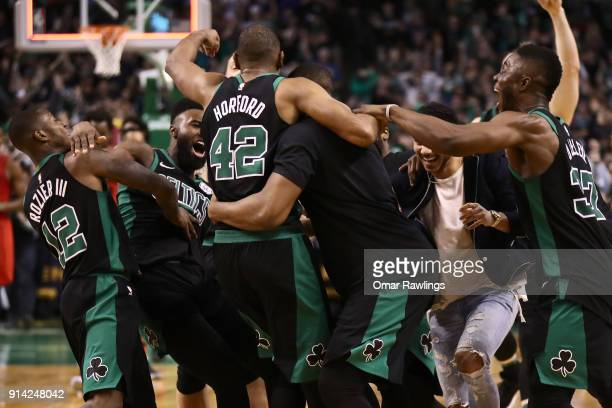 Al Horford is mobbed by the rest of the Boston Celtics after scoring the game winning shot at the end of the game against the Portland Trail Blazers...