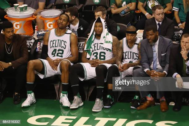 Al Horford Marcus Smart and Isaiah Thomas of the Boston Celtics react on the bench during the fourth quarter against the Cleveland Cavaliers in Game...