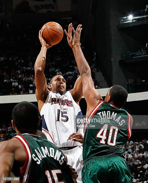 Al Horford of the Atlanta Hawks against John Salmons and Kurt Thomas of the Milwaukee Bucks during Game Five of the Eastern Conference Quarterfinals...