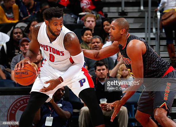 Al Horford of the Atlanta Hawks defends against Andre Drummond of the Detroit Pistons at Philips Arena on October 27 2015 in Atlanta Georgia NOTE TO...
