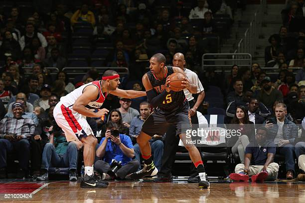 Al Horford of the Atlanta Hawks defends the ball against the Washington Wizards during the game on April 13 2016 at Verizon Center in Washington...