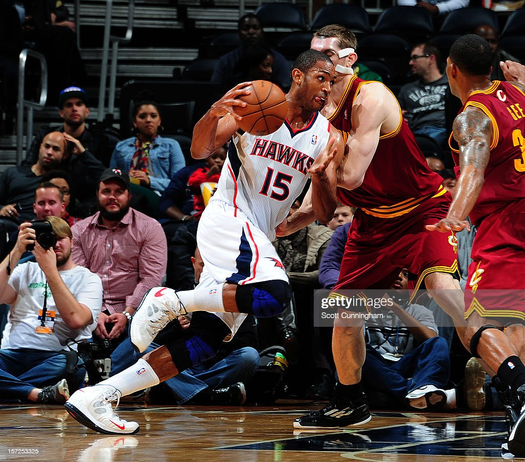 Al Horford #15 of the Atlanta Hawks drives to the basket against Tyler Zeller #40 of the Cleveland Cavaliers at Philips Arena on November 30, 2012 in Atlanta, Georgia.