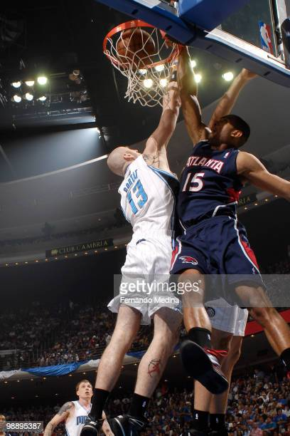 Al Horford of the Atlanta Hawks dunks against Marcin Gortat of the Orlando Magic in Game Two of the Eastern Conference Semifinals during the 2010 NBA...