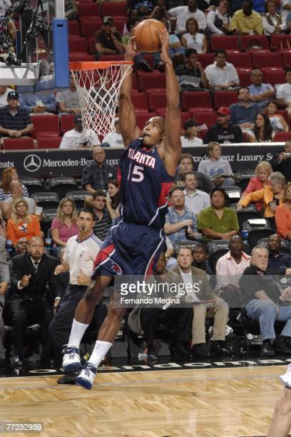 Al Horford of the Atlanta Hawks dunks against the Orlando Magic at Amway Arena on October 8 2007 in Orlando Florida NOTE TO USER User expressly...