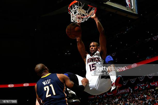 Al Horford of the Atlanta Hawks dunks on David West of the Indiana Pacers during Game Three of the Eastern Conference Quarterfinals of the 2013 NBA...
