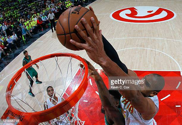 Al Horford of the Atlanta Hawks dunks over Amir Johnson of the Boston Celtics in Game One of the Eastern Conference Quarterfinals during the 2016 NBA...