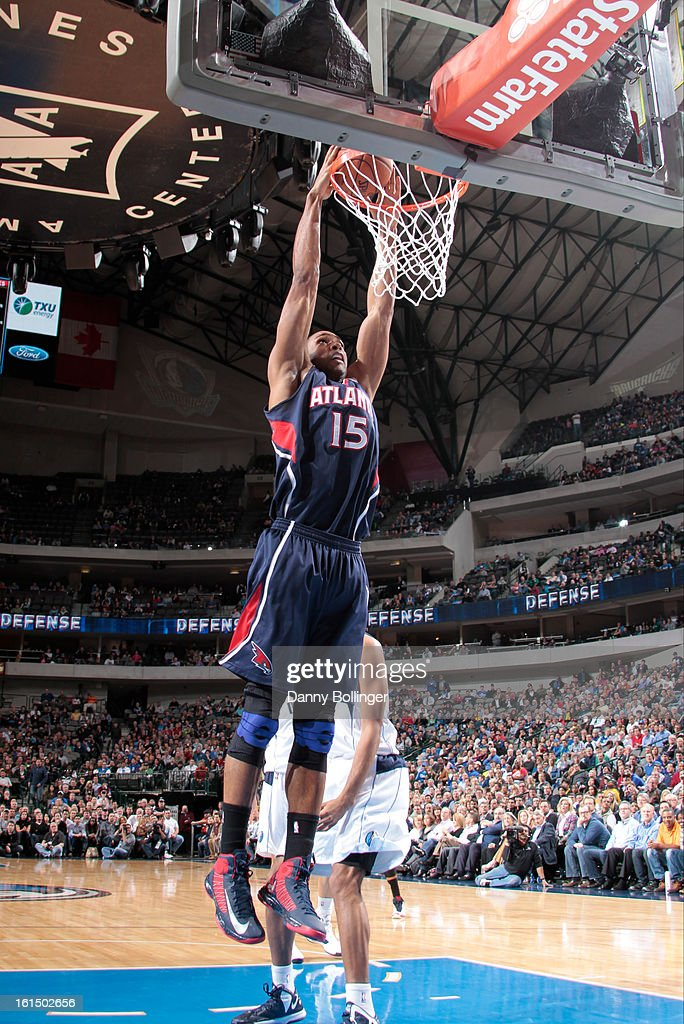 Al Horford #15 of the Atlanta Hawks dunks the ball against the Dallas Mavericks on February 11, 2013 at the American Airlines Center in Dallas, Texas.