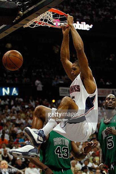 Al Horford of the Atlanta Hawks dunks the ball over Kevin Garnett of the Boston Celtics in Game Six of the Eastern Conference Quarterfinals during...