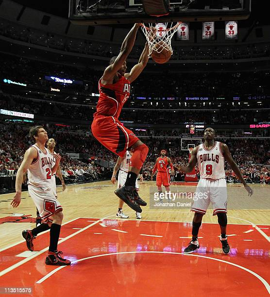 Al Horford of the Atlanta Hawks dunks the ball over Kyle Korver and Loul Deng of the Chicago Bulls in Game One of the Eastern Conference Semifinals...