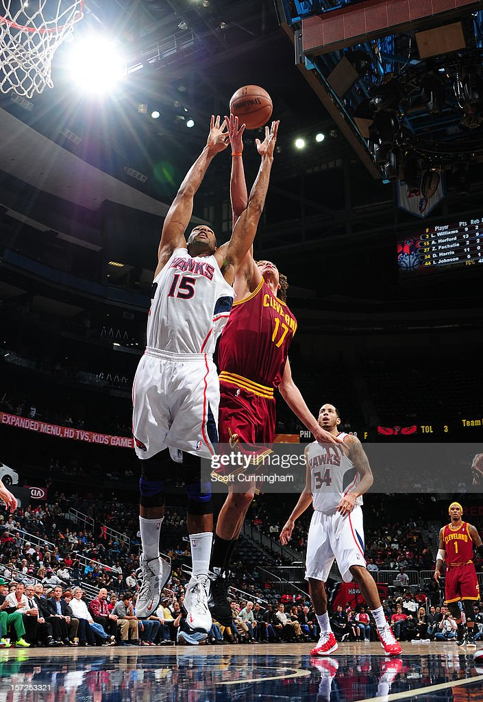 Al Horford #15 of the Atlanta Hawks grabs a rebound over Anderson Varejao #17 of the Cleveland Cavaliers at Philips Arena on November 30, 2012 in Atlanta, Georgia.