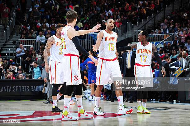 Al Horford of the Atlanta Hawks high fives teammates during the game against the New York Knicks on December 26 2015 at Philips Arena in Atlanta...