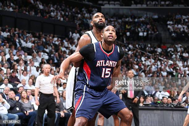 Al Horford of the Atlanta Hawks looks for the rebound against Alan Anderson of the Brooklyn Nets during Game Four of the Eastern Conference...