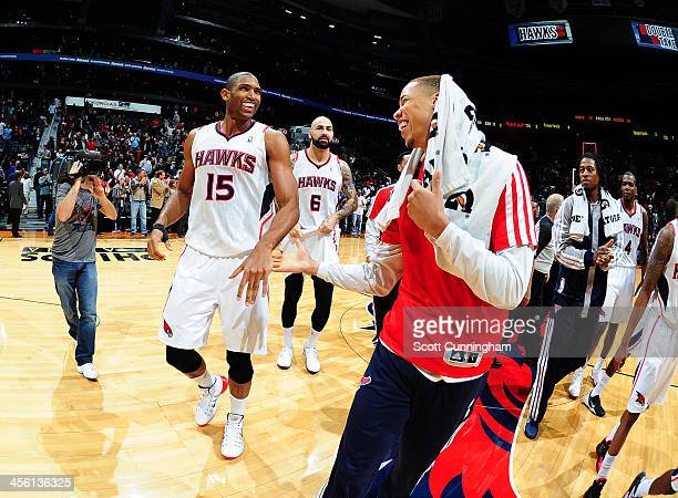Al Horford of the Atlanta Hawks looks on after he hit the game winning shot against the Washington Wizards on December 13 2013 at Philips Arena in...