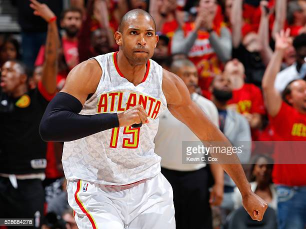 Al Horford of the Atlanta Hawks reacts after hitting a threepoint basket against the Cleveland Cavaliers in Game Three of the Eastern Conference...