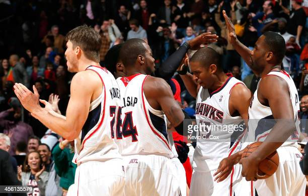 Al Horford of the Atlanta Hawks reacts after hitting the gamewinning basket in a 10199 overtime win over the Washington Wizards at Philips Arena on...