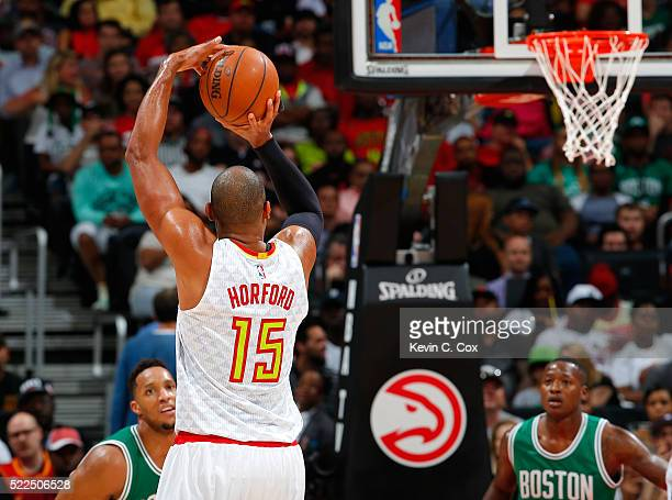 Al Horford of the Atlanta Hawks shoots a threepoint basket against the Boston Celtics in Game Two of the Eastern Conference Quarterfinals during the...