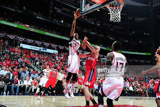 Al Horford of the Atlanta Hawks shoots against Marcin Gortat of the Washington Wizards in Game Five of the Eastern Conference Semifinals during the...