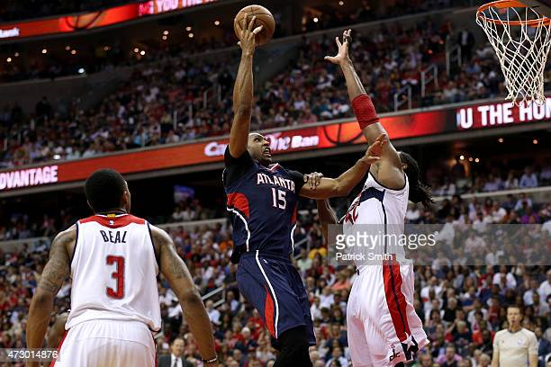 Al Horford of the Atlanta Hawks shoots in front of Nene of the Washington Wizards during the second half in Game Four of the Eastern Conference...