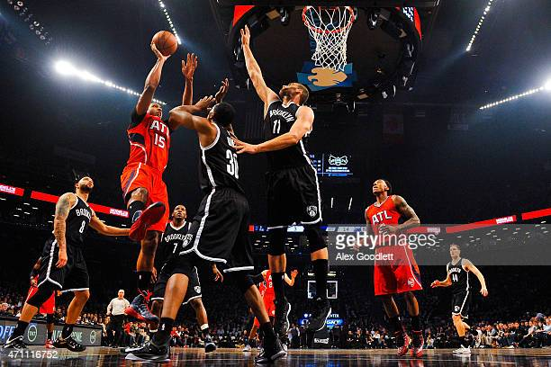 Al Horford of the Atlanta Hawks shoots over Thaddeus Young and Brook Lopez of the Brooklyn Nets during the first round of the 2015 NBA Playoffs at...