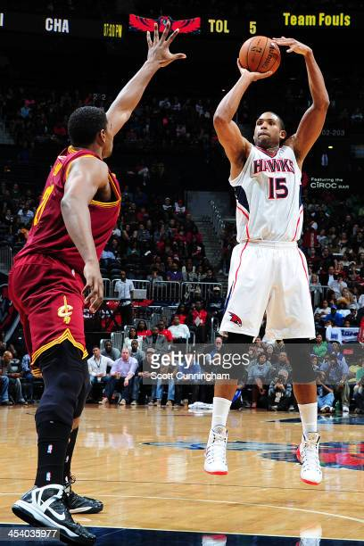 Al Horford of the Atlanta Hawks shoots the ball against the Cleveland Cavaliers on December 6 2013 at Philips Arena in Atlanta Georgia NOTE TO USER...