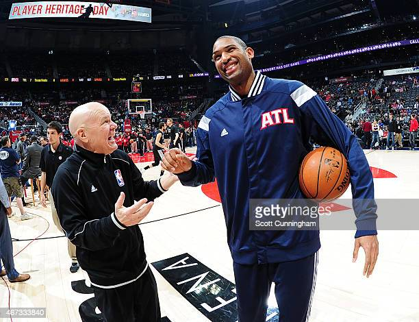Al Horford of the Atlanta Hawks talks with referee Joey Crawford before the game against the San Antonio Spurs on March 22 2015 at Philips Arena in...