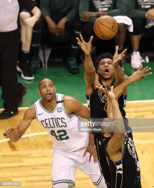 Al Horford of the Boston Celtics and Giannis Antetokounmpo of the Milwaukee Bucks battle for a rebound during the third quarter in Game Five in Round...