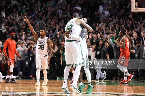Al Horford of the Boston Celtics and Terry Rozier of the Boston Celtics celebrate on the court against the Houston Rockets on December 28 2017 at the...