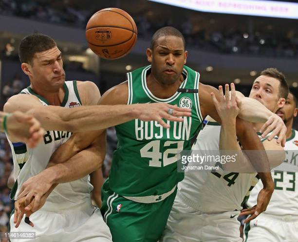 Al Horford of the Boston Celtics battles for a rebound with Brook Lopez and Pat Connaughton of the Milwaukee Bucks at Fiserv Forum on April 30 2019...