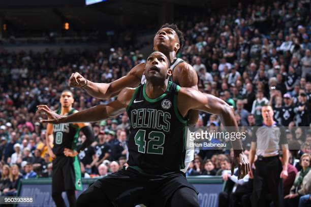 Al Horford of the Boston Celtics boxes out Giannis Antetokounmpo of the Milwaukee Bucks in Game Four of Round One of the 2018 NBA Playoffs on April...