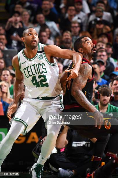 Al Horford of the Boston Celtics boxes out JR Smith of the Cleveland Cavaliers during Game Seven of the Eastern Conference Finals of the 2018 NBA...