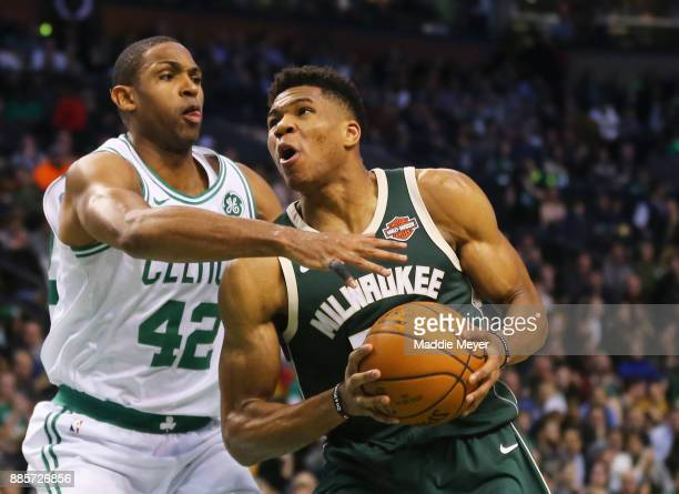 Al Horford of the Boston Celtics defends Giannis Antetokounmpo of the Milwaukee Bucks during the second quarter at TD Garden on December 4 2017 in...