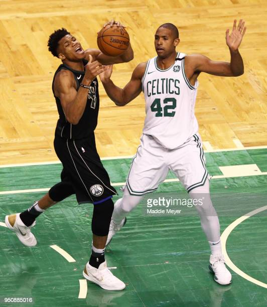 Al Horford of the Boston Celtics defends Giannis Antetokounmpo of the Milwaukee Bucks during the first quarter of Game Five in Round One of the 2018...