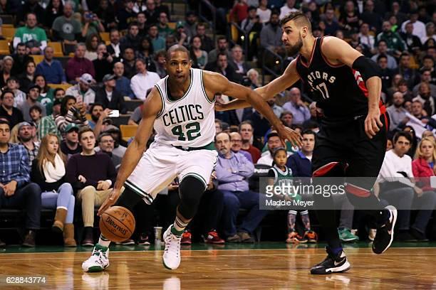 Al Horford of the Boston Celtics drives against Jonas Valanciunas of the Toronto Raptors during the second half at TD Garden on December 9 2016 in...