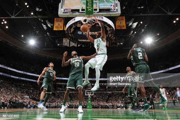 Al Horford of the Boston Celtics dunks the ball against the Milwaukee Bucks on December 4 2017 at the TD Garden in Boston Massachusetts NOTE TO USER...