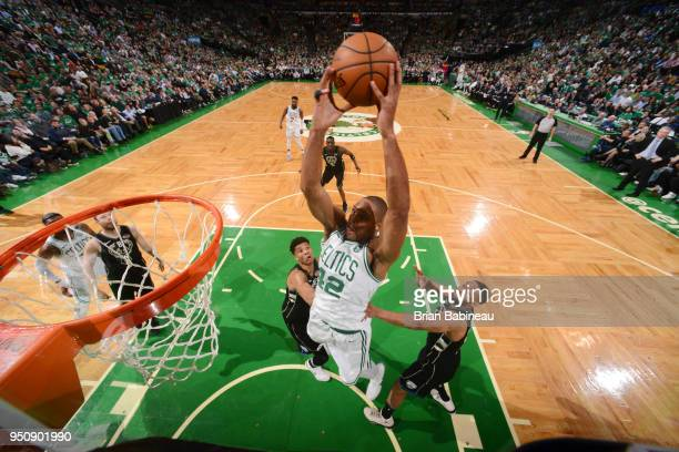 Al Horford of the Boston Celtics dunks the ball against the Milwaukee Bucks Game Five of Round One of the 2018 NBA Playoffs on April 24 2018 at the...