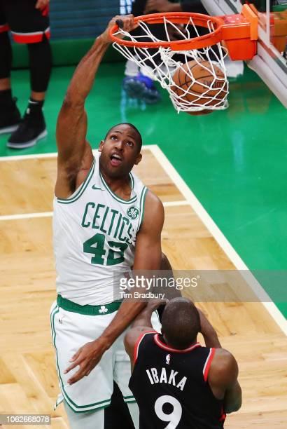 Al Horford of the Boston Celtics dunks the ball during overtime against the Toronto Raptors at TD Garden on November 16 2018 in Boston Massachusetts