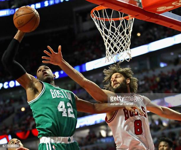 Al Horford of the Boston Celtics grabs a rebound over Robin Lopez of the Chicago Bulls during Game Four of the Eastern Conference Quarterfinals...