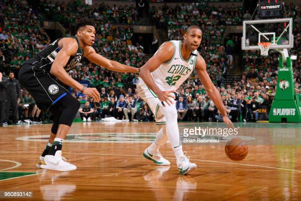 Al Horford of the Boston Celtics handles the ball against Giannis Antetokounmpo of the Milwaukee Bucks during Game Five of Round One of the 2018 NBA...