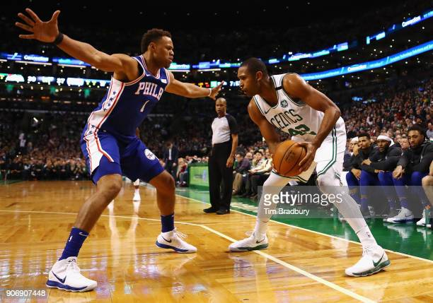 Al Horford of the Boston Celtics handles the ball against Justin Anderson of the Philadelphia 76ers during the first half of their game at TD Garden...