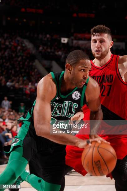 Al Horford of the Boston Celtics handles the ball against Jusuf Nurkic of the Portland Trail Blazers on March 23 2018 at the Moda Center in Portland...