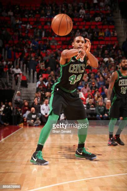Al Horford of the Boston Celtics handles the ball against the Detroit Pistons on December 10 2017 at Little Caesars Arena in Detroit Michigan NOTE TO...