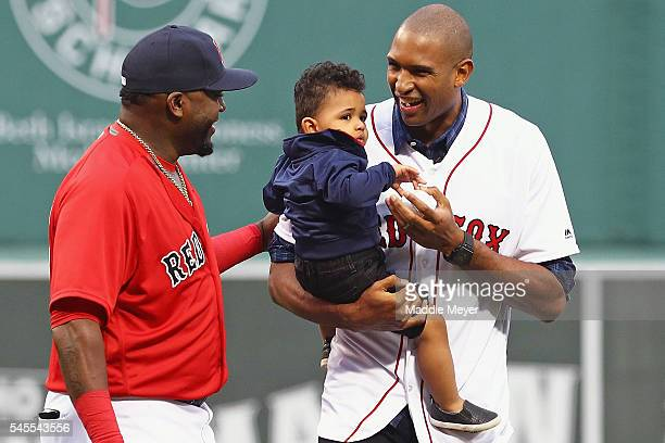 Al Horford of the Boston Celtics holding his son Ean talks with David Ortiz of the Boston Red Sox after throwing out the first pitch before the game...