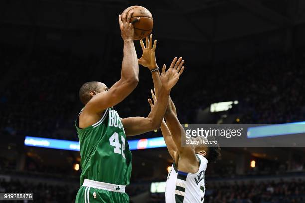 Al Horford of the Boston Celtics is defended by Giannis Antetokounmpo of the Milwaukee Bucks during the first half of game three of round one of the...